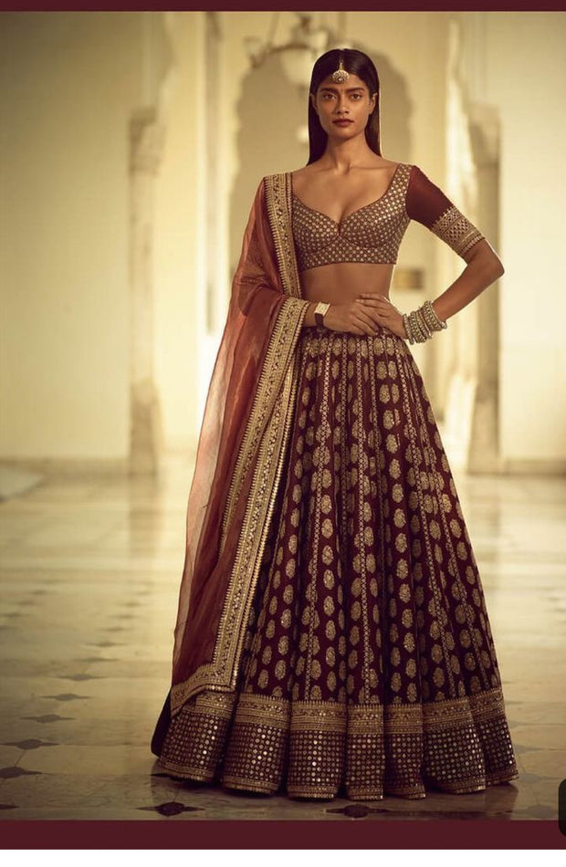 Maroon Bridal Ghaghra Choli In Dark Maroon Color.Work Embellished With Dabka,Zari,Nagh,And,Sequance Work.