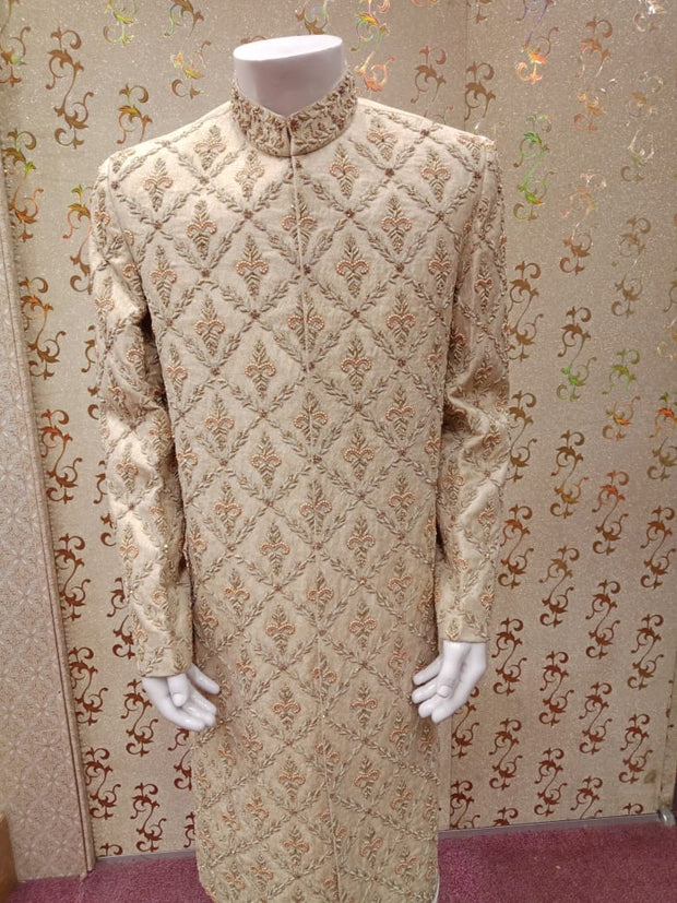 Pakistani Latest Sherwani In Offwhite Gold Color Work Embellished With Pure Dabka And Beeds Work.Same Work on Khusa.