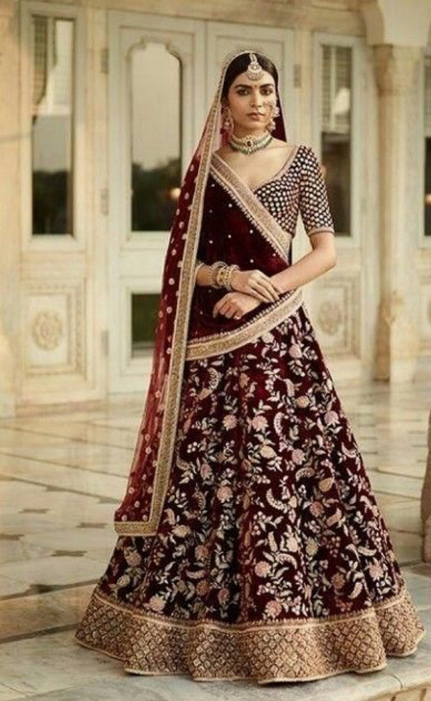 Traditional Ghaghra Choli In Maroon Color.Work Embellished With Dabka,Zari,Threads And Sequance Work.