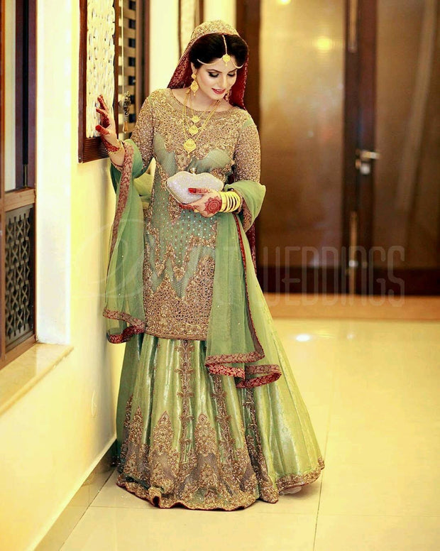 Traditional Walima Lahnga In Parrot Green Color.Work   Embalmed With Pure Dabka Nagh Zari Nagh Perarls And Cutwork.