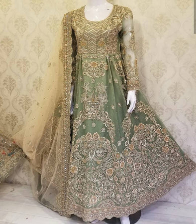 Walima Dulhan Suit In Mint Green Color.Work Embalished With Dabka,Zari,Nagh,Threads And Zardozi Work.