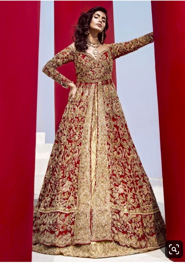 Dulhan Maxi Lahnga In Hot Red Color.Work Embellished With Heavy Dabka Nagh Zari Crystal And Nagh Work.