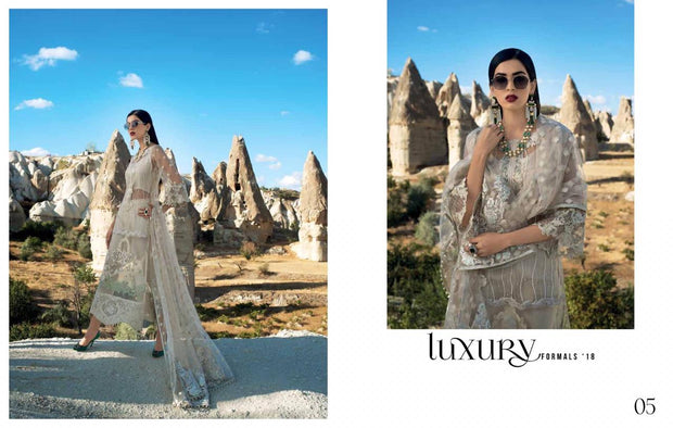 Pakistani Party Dress In Pearl White Color by Zainab Chotani.With Threads Embroidery And Sequance.