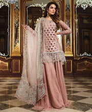Pakistani Bridal Sharara in Beutiful Baby Pink Color By Maria.B With Cutwork Jaal,Handwork,Sequance,And Tilla Threads Embroidery.