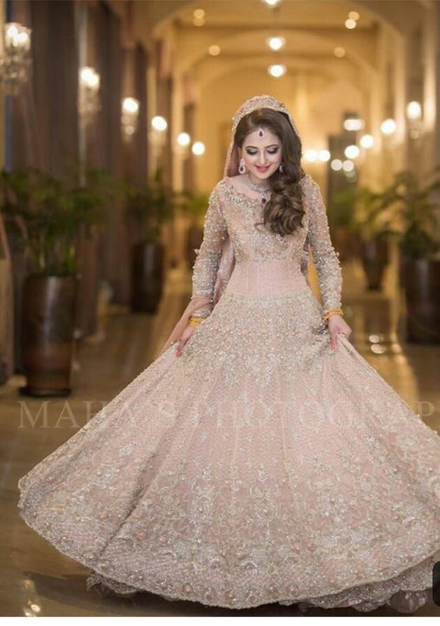 Walima Dulhan Maxi in Beutifull Pastel Pink Color.Work Embellished With Pure Dabka,Dhaga,Zari,Naqshe,And Pearls Work.This Dress Can Changeable In Any Desiring Color.