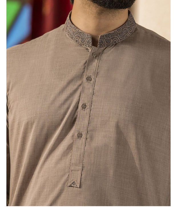 Pakistani Men Dress in Light Brown Color.Pure Threads Embroidery On Neck And Collar.