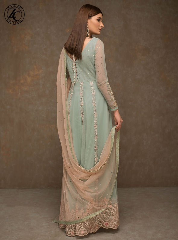 Indian Anarkali Frock In Turquoise And Baby Pink Color.Work Embleshid With Dabka Dhaga,Zari Pearls And Stone Work.