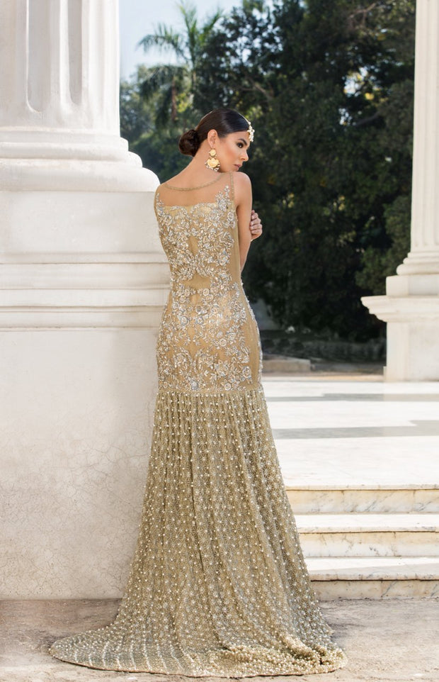 Beautiful embroidered Asian bridal out in alluring gold color