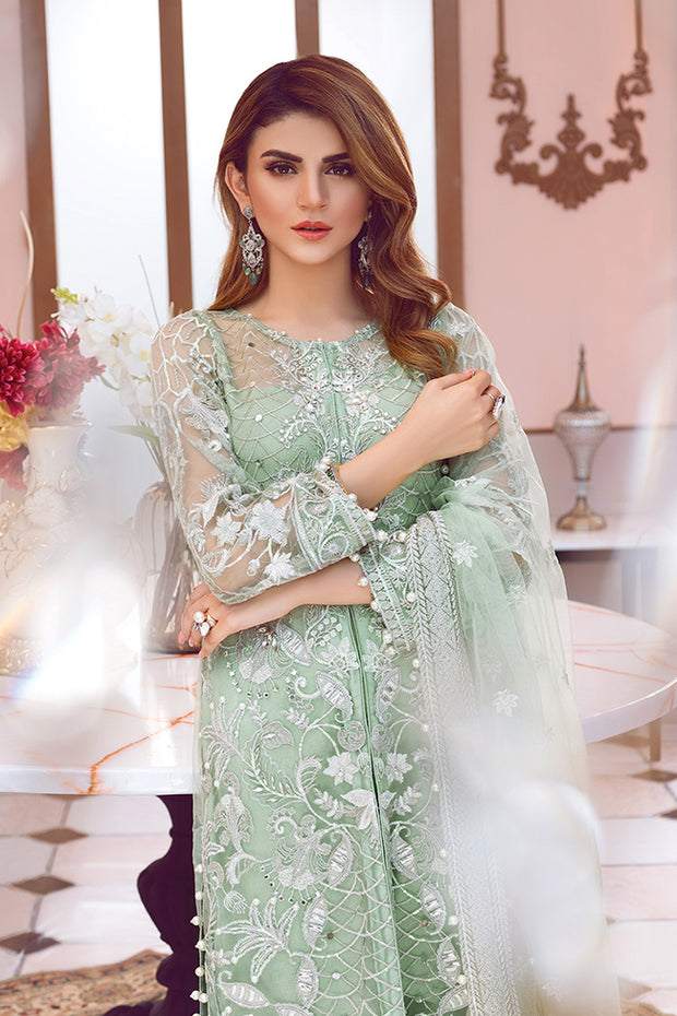 Beautiful designer Asian net embroidered outfit in green color
