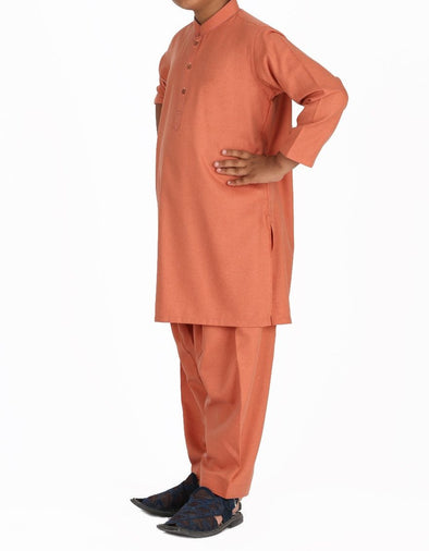 Beautiful Pakistani boy dress in rust color for casual wear