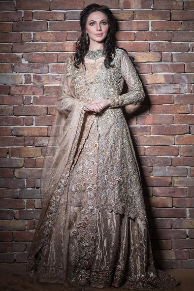Elegant Pakistani bridal lehnga outfit in copper color