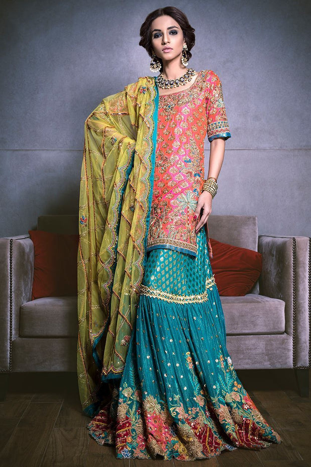 Beautiful bridal mehndi lehnga in orange and turquoise color