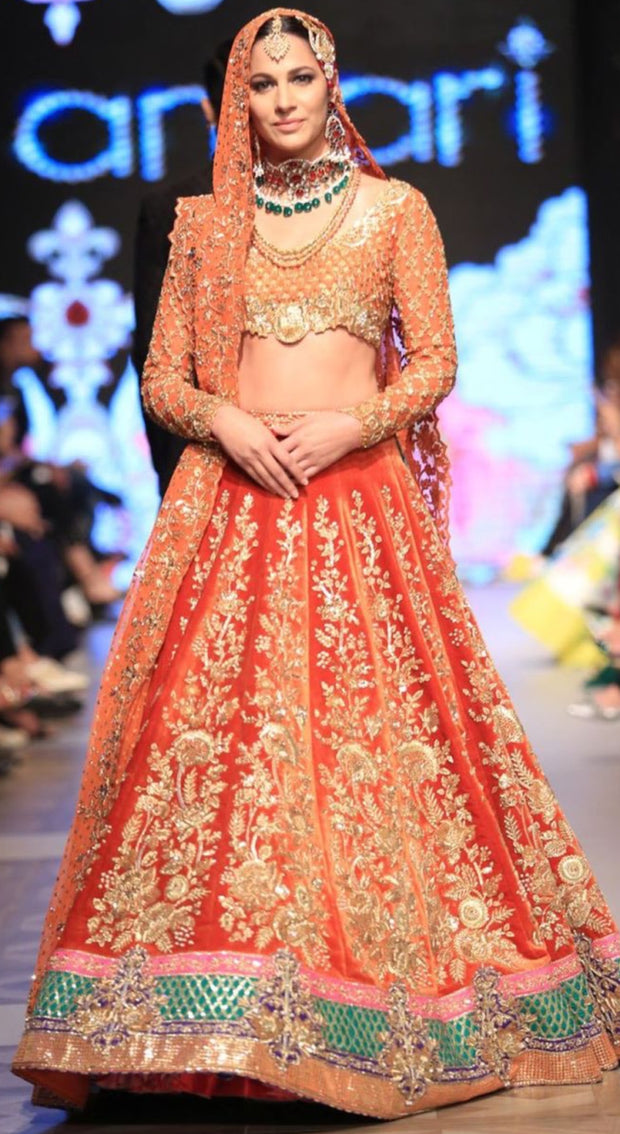 Bridal Ghagra Choli in Beutifull Reddish Orange Color.Work Embalished With Dabka Zari Naqshe Pearls Sequance And Sitara Work.