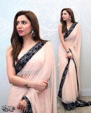 Stylish Indian Saree In Light Baby Pink Color.Work Embalished With Black Threads Embroidery And Sequance Borders.In Middle Of Saree All Sequance Work.