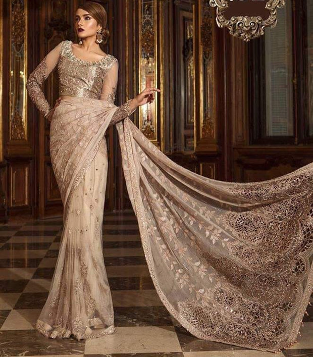 Designer Pakistani Saree In Pink Gold Color With Beautiful Handwork On Blouse Neck With Tilla,Threads Embroidery Sequance And Pearls Work.