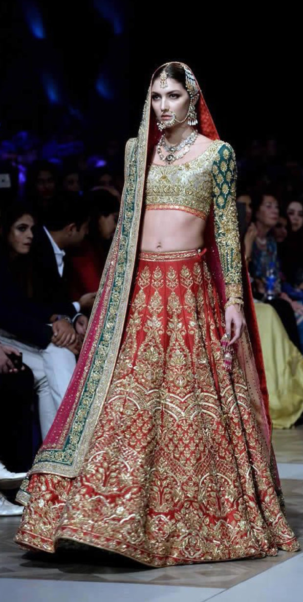 Nomi Ansari Bridal Lahnga Choli In Hot Red Color In In Indian Style.Work Embalished With Pure Dull Gold Dabka,Zari,Nagh Sequance And Green Appliqué Work.