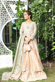 Beautiful designer embroidered bridal dress in rose gold color