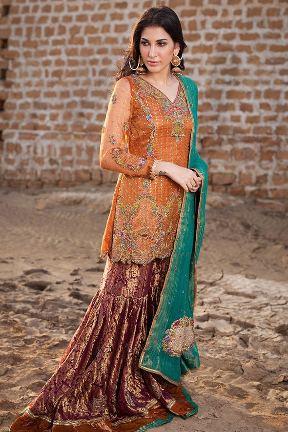 Pakistani designer gharara dress in copper and orange color