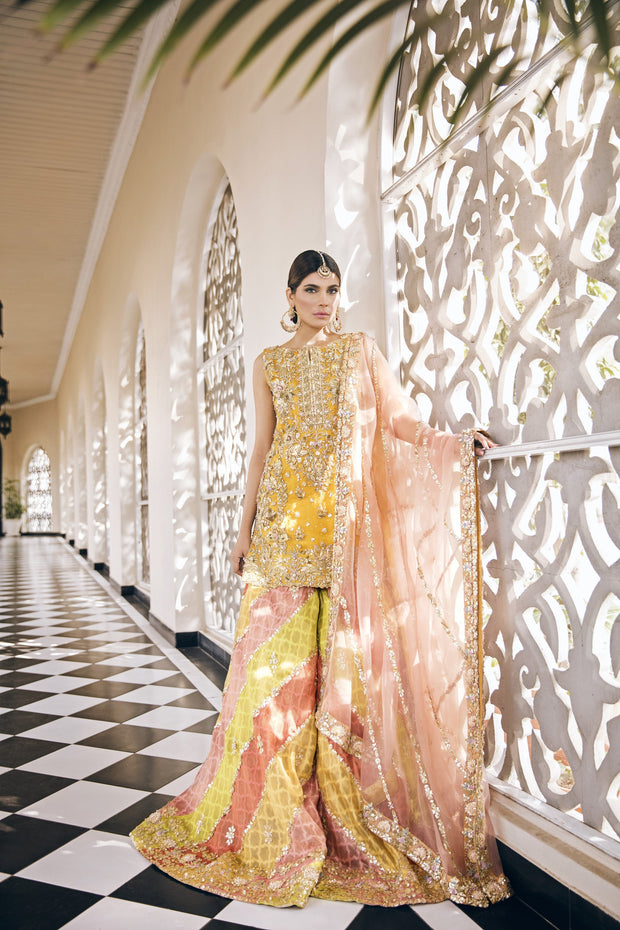 Beautiful embroidered designer mehendi outfit in yellow color
