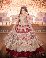Dulhan Bridal Dress In Beutifull Maronish Red Color.Work Embellished With Pure Dull Gold Dabka Naqshee,Zari,Tilla,Crystal,Stone,And Dhaga Work.This Dress Is Proper Customized. Can Customized In Any Color.And Also Can Change Desiring Fabric.