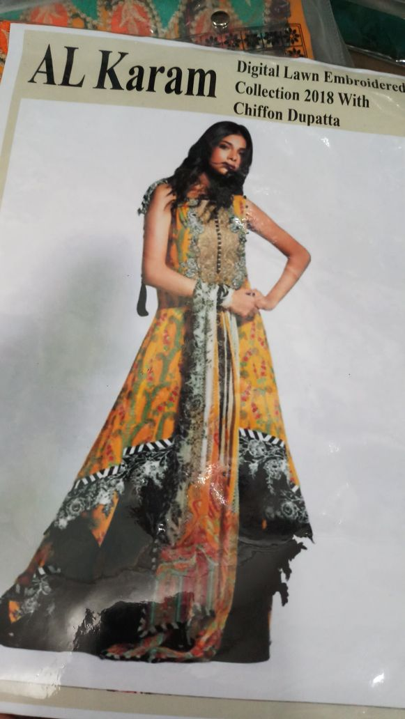 Beutifull lawn dress by alkaram in yellow black color Model# L 1190 sold out
