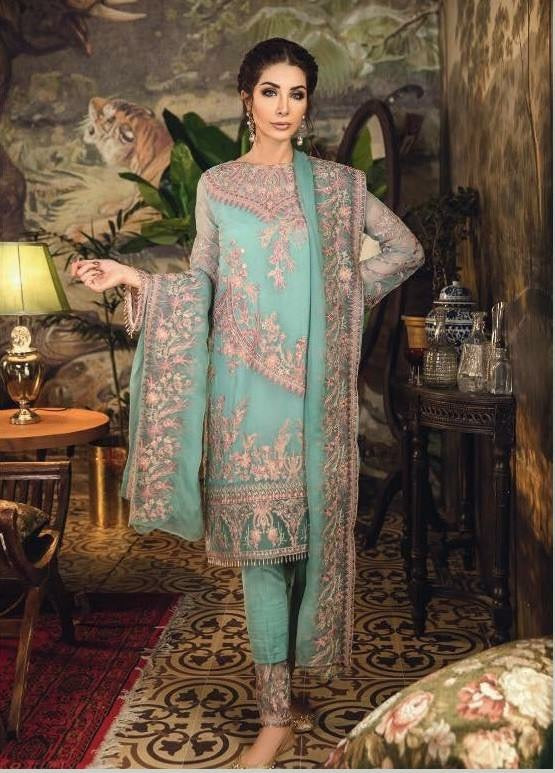 Pakistani Designer Dress In Beautiful Turquoise Color.Work Embellished With Tilla Threads Embroidery And Patches Work.