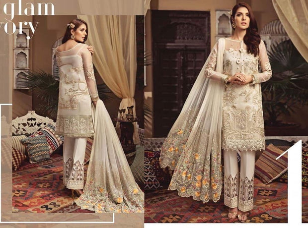 Pakistani Party Suit in Offwhite Color by Sarene.Work With Beautiful Dhaga Work Tilla Embroidery And Cutwork Patches.