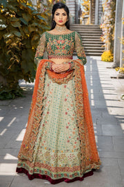Elegant bridal dress in ghaghra choli style in green color