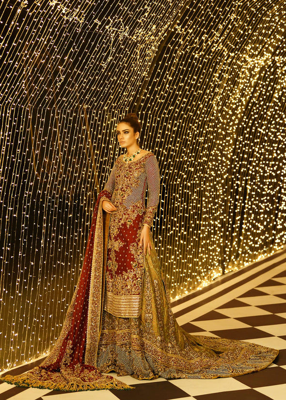 Embroidered Pakistani bridal lehnga in gold and maroon color