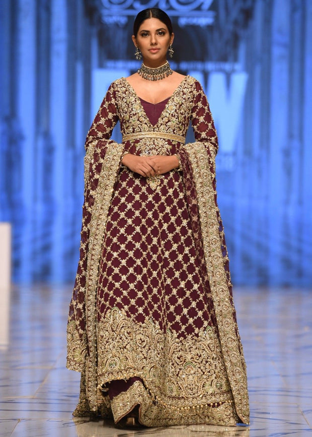 Embroidered bridal frock in maroon color with skin gold embroidery