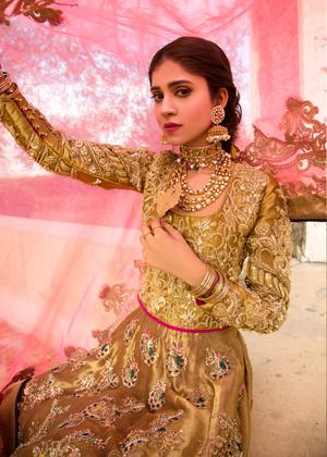 Pakistani embroidered frock dress for bridal wear in dull gold color