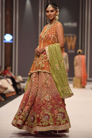 Beautiful embroidered mehndi dress embroidered in orange color