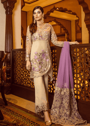 Pakistani designer embroidered organza dress in skin color