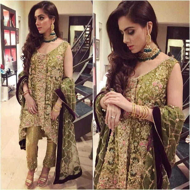 Bridal dress in parrot green color for nikah bride  with heavy dabka nagh   and crystals work Model #B 1117