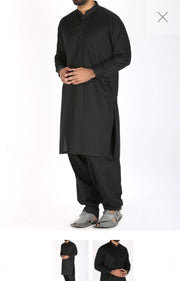 Black Men Suit By Junaid Jamshed. Work Embellished Plain Haming On Neck Collar And Sleeves Cuffs.