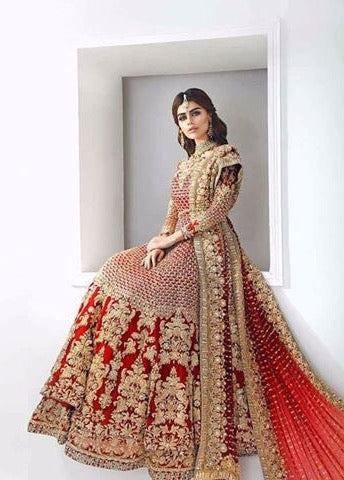 Beautiful heavy bridal lahnga in red color Model#W 843