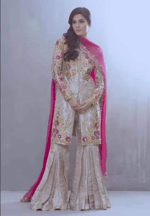 Beautiful gharara set in shoking pink and skin gold color Overall Look