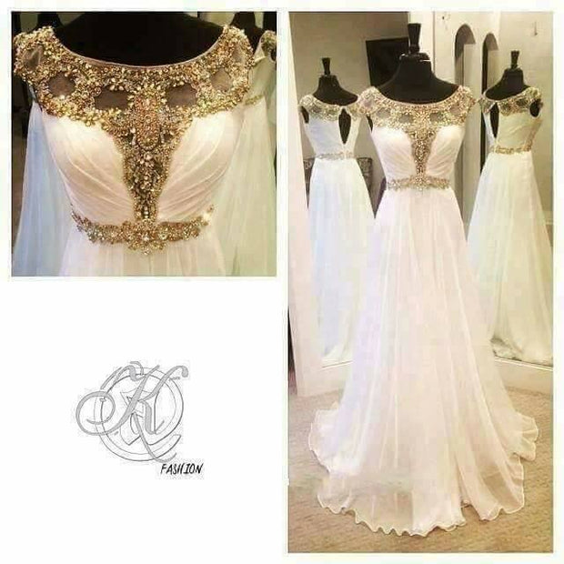 Beutifull maxi in white color with golden antique work Model #W 1111