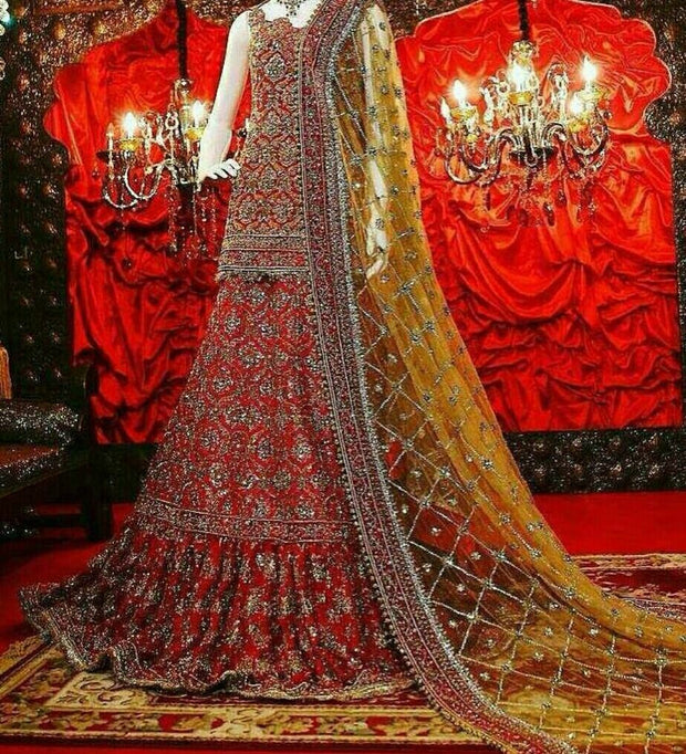 Beutifull bridal lahnga in maroonish red and greenish golden color
