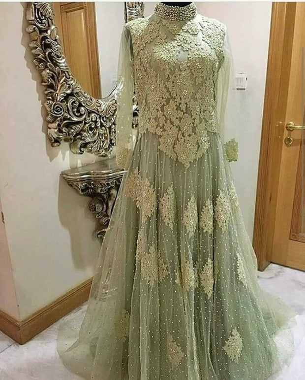 Bridel maxi withdabka nagh perls and threads work color light pistheo green colour on net cloth model#B 21