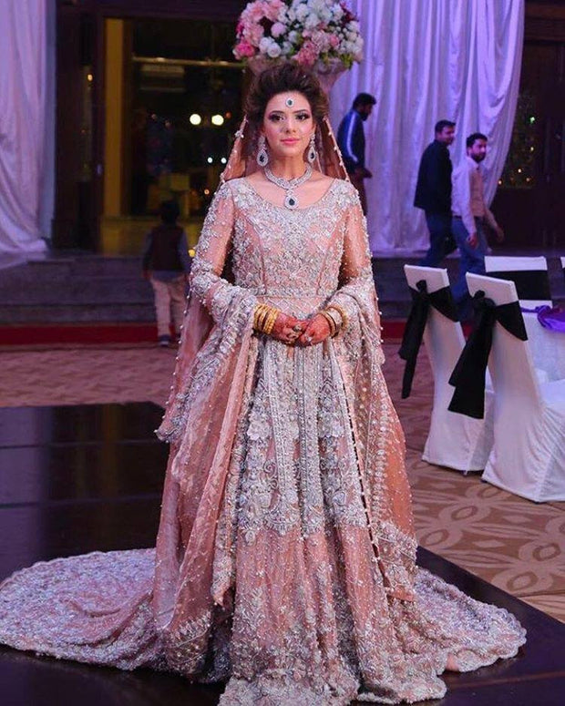 Light pink and silver bridal lahnga set with nagh cutwork threads dabka zari and nagh work Model#L 23