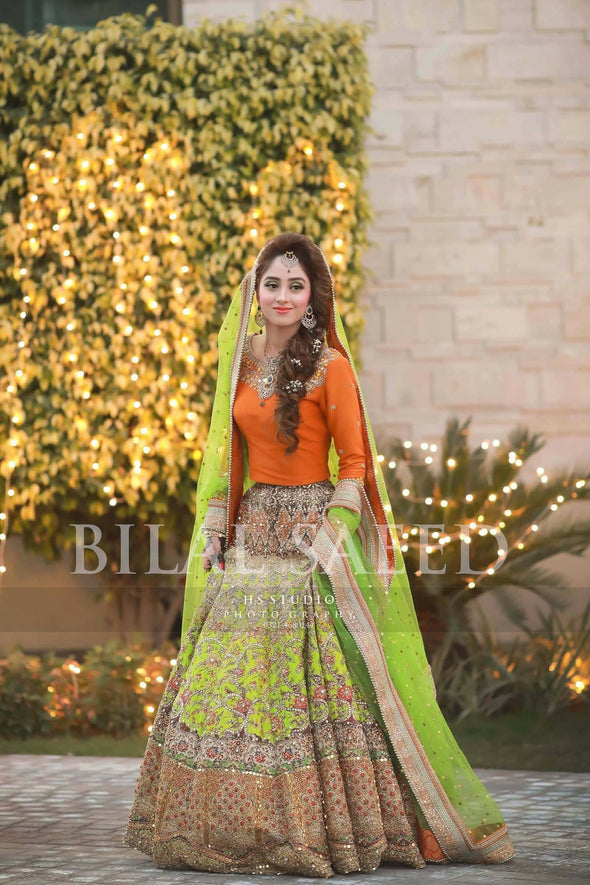 Orange and green lhnga for mehndi bride work with blockprinting dabka sitara and threads  Model#M47