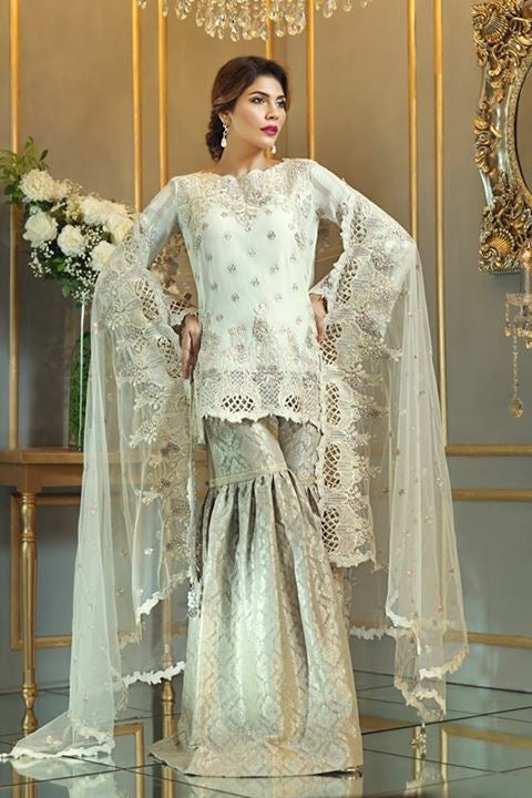 Chiffon dress by Anya in light golden color with threds tila embroidery and patch works Model#C 572