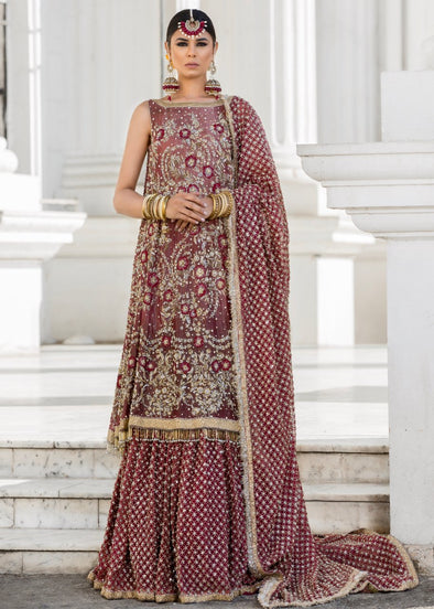 Beautiful embroidered Indian bridal outfit in reddish maroon color