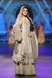 Indian designer embroidered dress in white and gold color