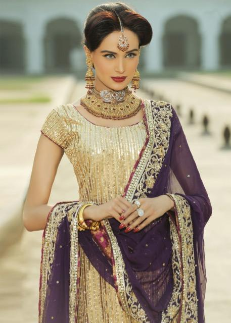Latest Indian embroidered bridal outfit in gold and purple color
