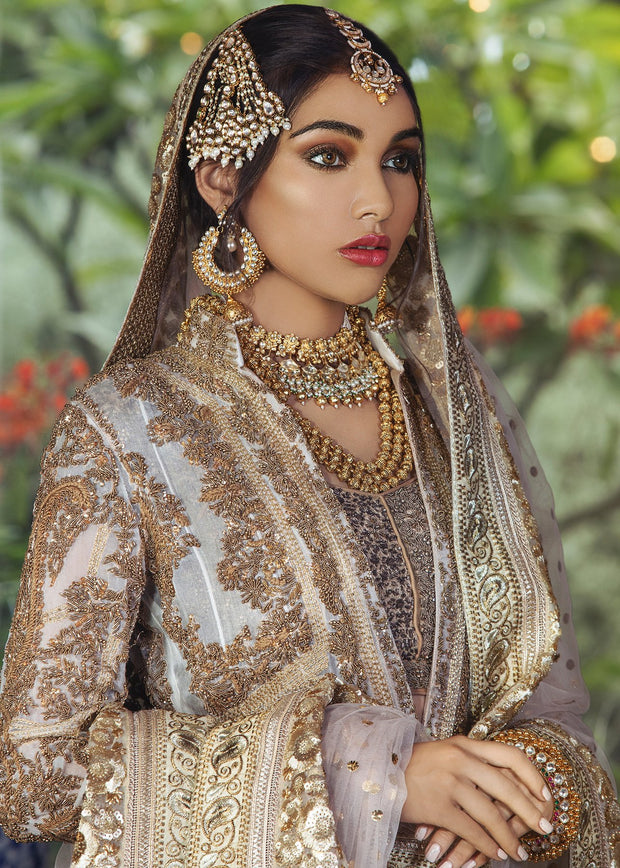 Beautiful Pakistani bridal lehnga outfit for wedding in champagne color