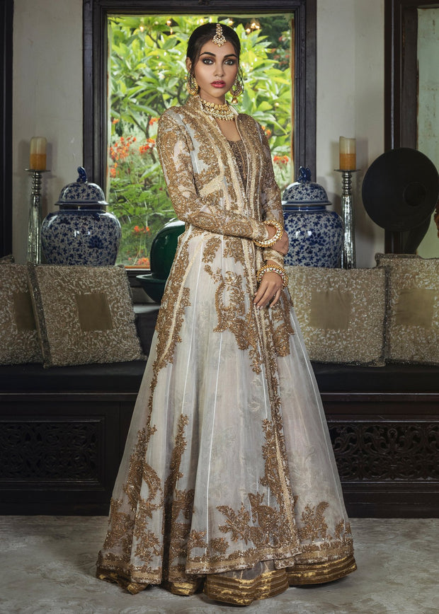 Beautiful Pakistani bridal lehnga outfit for wedding in champagne color # B3452