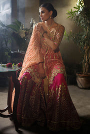Beautiful designer mehndi dress embroidered in gold pink color