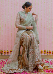 Latest net embroidered bridal outfit in rust orange color for wedding wear